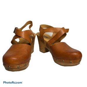 Korks brown leather mules with cross straps